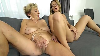 Blonde beauty in lesbo action with a granny