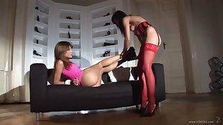 Radiant lesbian in nylon stockings masturbating erotically with a vibrator