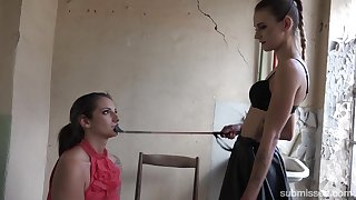 Skinny wicked mistress dominates a slave bigger than their way